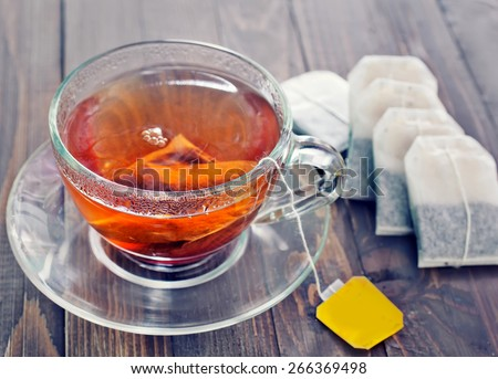 tea in glass cup on the wooden table - stock photo