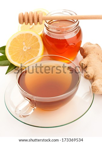 Tea in glass cup with honey, lemon and ginger - stock photo
