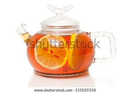 Tea in Glass Teapot With Lemon Slice - stock photo