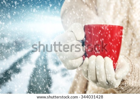 tea in red mug and road  - stock photo