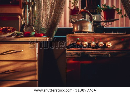 Tea kettle with boiling water on gas stove - stock photo