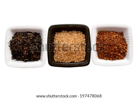 tea leaves, brown sugar and grounded coffee in a white ceramic container over white background
