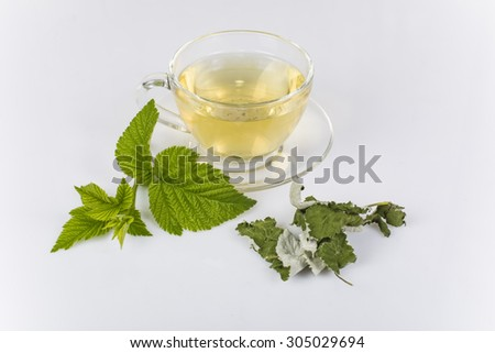 tea made from raspberry leaves in a glass Cup