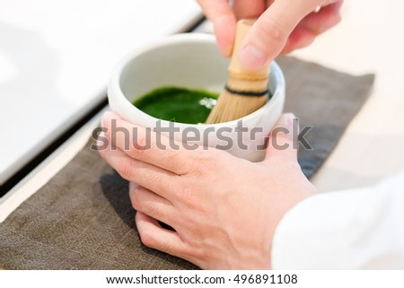 Tea master make matcha tea with tea whisk