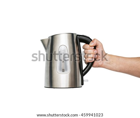 Tea metal kettle with boiling water in the kitchen close up, Women hand hold the iron electric kettle, preparing hot drink, click on the button