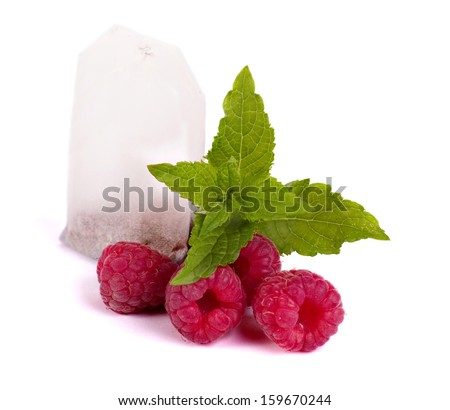 Tea package with raspberry - stock photo