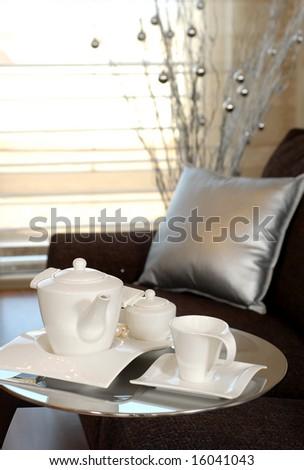 tea pot on a service table - stock photo