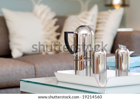 Tea pot on the coffee table in the living room - stock photo