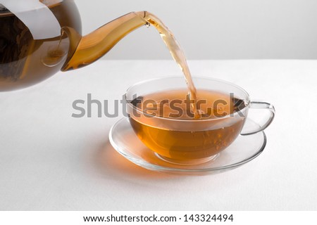 tea poured from a teapot - stock photo