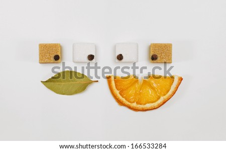 Tea / punch  ingrendients creatively arranged as couple smiling and looking one to each other - stock photo