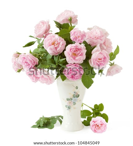 Tea roses bunch in vase isolated on white background