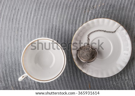 Tea set on the grey relief background  top view