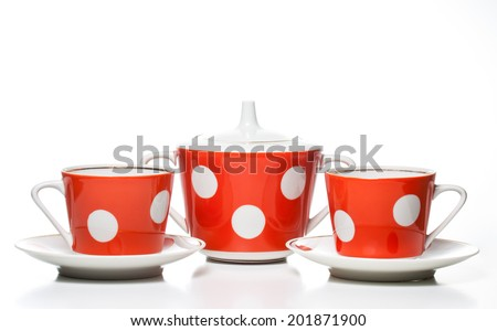 Tea set on white background. Two cups  with saucers  and  Sugar bowl,  red and  white polka dots.  Tea time.  Coffee set.  Porcelain dishes, nice tableware. - stock photo