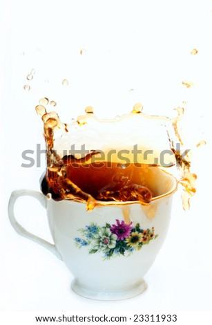 Tea splash from a cup on the white background
