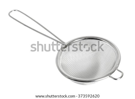 Tea strainer (small sieve) with handle. Isolated with clipping path. - stock photo