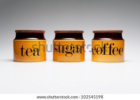Tea, Sugar and Coffee crockery pots. - stock photo