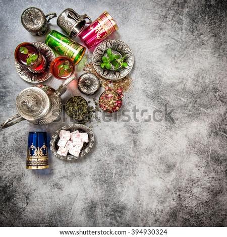 Tea table. Oriental hospitality. Eid Mubarak. Vintage style dark toned picture - stock photo