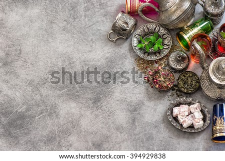 Tea table place setting with colorful glasses. Oriental hospitality concept - stock photo