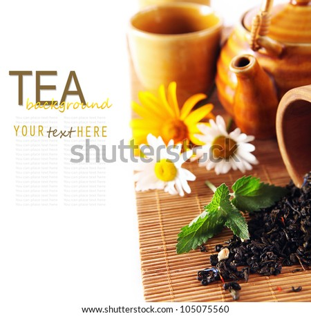 Tea theme background with daisy flowers and fresh mint - stock photo