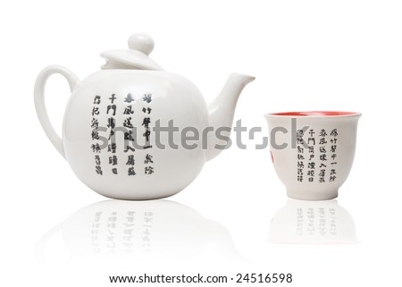 Tea-things in asian style with hieroglyphics. Isolated on white. - stock photo