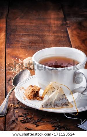 Tea time. Black tea and cookie - stock photo
