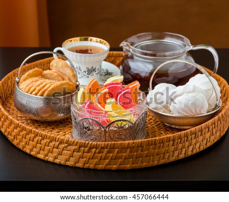Tea time with old fashioned candies and cookies in vintage bowls. Selective focus, shallow dof. - stock photo