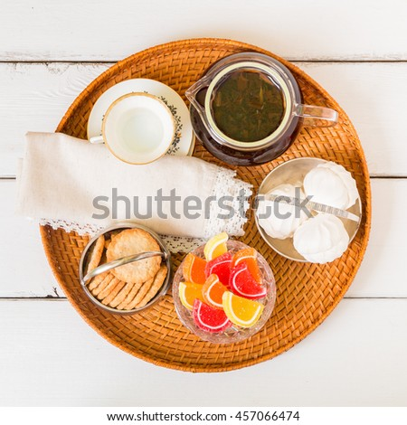Tea time with old fashioned candies and cookies in vintage bowls. Top view. - stock photo