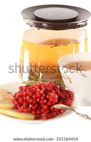 Tea with cowberries marmalade or jam isolated on the white background