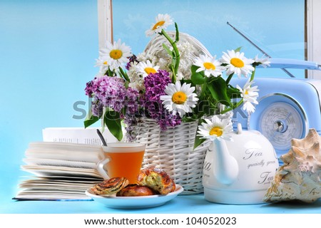 Tea with flowers on the blue background