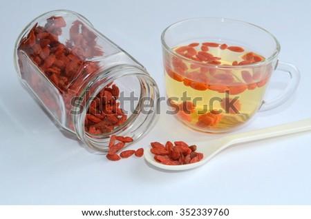 Tea with goji berries - stock photo