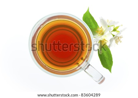 tea with jasmine flowers isolated on white, top view