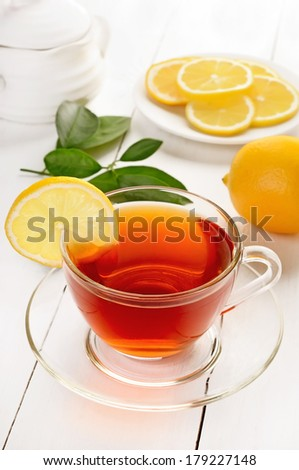 Tea with lemon on wooden table