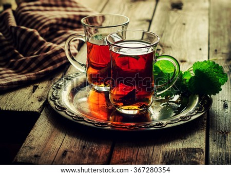 Tea with mint in the Arab style on wooden table. Selective focus. Instagram effect. - stock photo