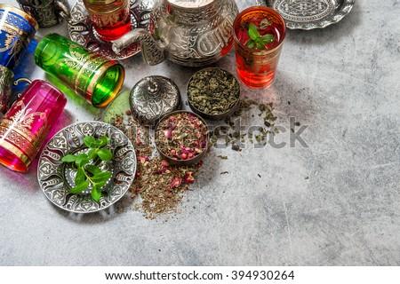 Tea with mint leaves and rose flower petals. Ramadan kareem - stock photo