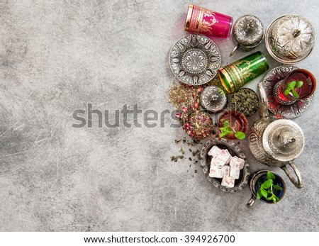 Tea with mint leaves and traditional turkish delight. Holidays table setting. Ramadan kareem. Top view - stock photo