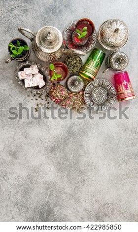 Tea with mint leaves and traditional turkish delight. Oriental hospitality arabic food concept. Ramadan kareem - stock photo