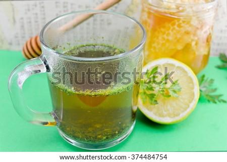 Tea with parsley, lemon and honey. Healthy beverage - stock photo