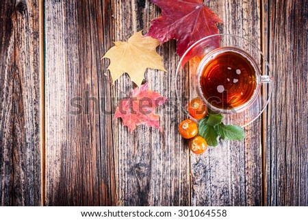 Tea with rosehip . Mineral berries in autumn and winter . Wellness warming drink . environmentally friendly product. traditional medicine . top view - stock photo
