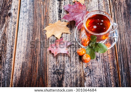 Tea with rosehip . Mineral berries in autumn and winter . Wellness warming drink . environmentally friendly product. traditional medicine . top view. Focus on the cup - stock photo