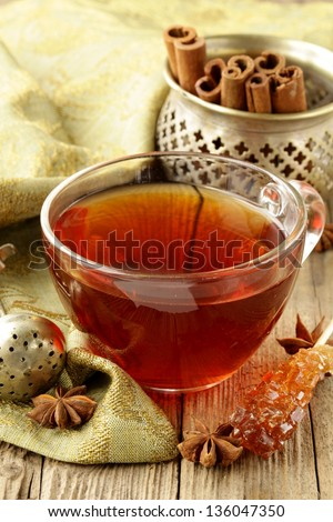 Tea with spices - cinnamon, a carnation and  anise - stock photo