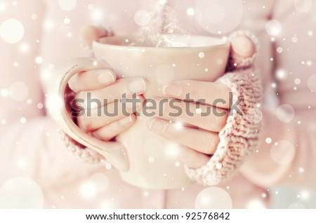 Tea. Woman holding tea cup. - stock photo