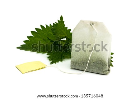 Teabag and fresh nettles leaves - stock photo