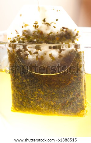 Teabag in the cup with hot water - stock photo
