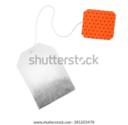 Teabag with red dotted label isolated on white background - stock photo