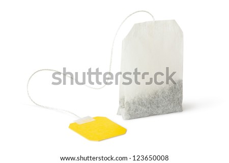Teabag with yellow label. Isolated on a white.