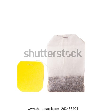 Teabag with yellow label. Isolated on white background - stock photo