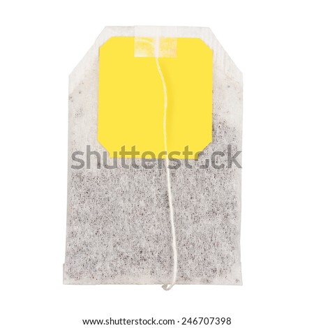 Teabag with yellow label. Isolated on white background. With clipping path - stock photo