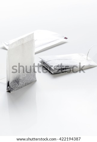 Teabags on white background.