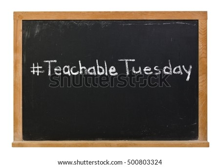 Teachable Tuesday written in white chalk on a black chalkboard isolated on white