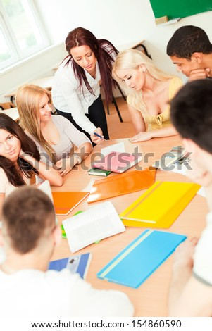 Teacher and College Students - stock photo